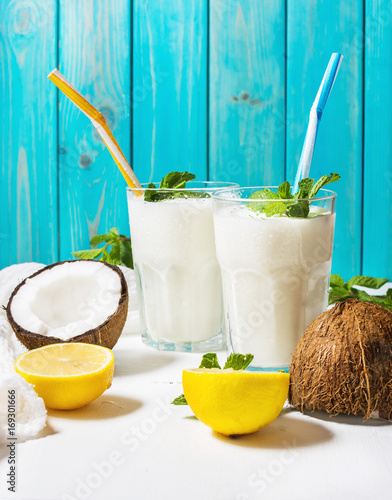 Fotografie, Obraz Coconut vegan milk coctail in glass on wooden background