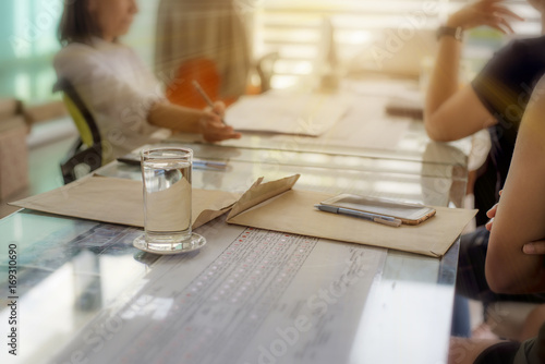 Fototapety, obrazy: Close-up water glass with background of business partners talking trading,consultant