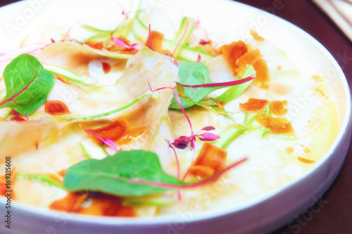 Poster Entree Carpaccio from artichoke and bottarga, toned