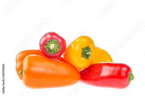 Fototapeta Pile of mini bell peppers paprika isolated on white background.
