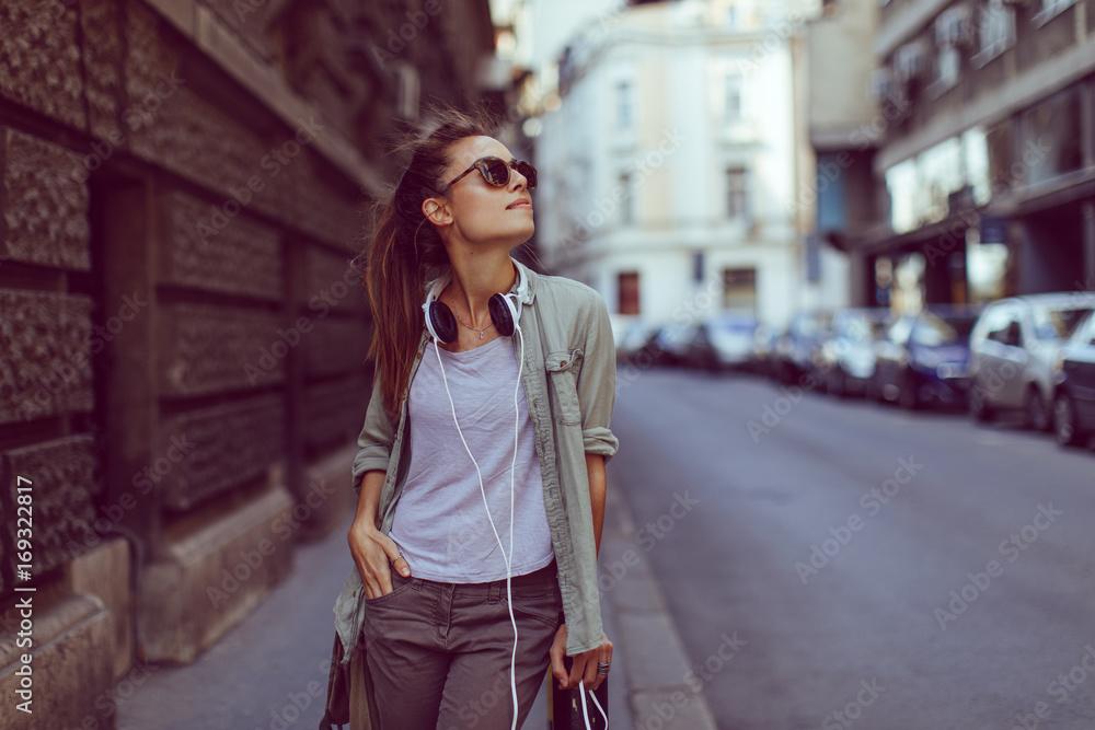 Fototapeta Young urban girl posing on sidewalk