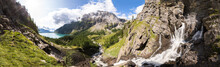 Panorama Of Torrent Stream, Lake, Green Valley In Alps Mountains