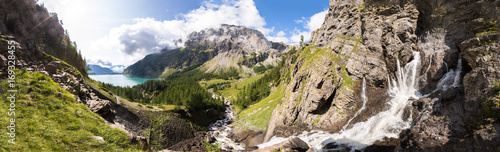 In de dag Alpen Panorama of torrent stream, lake, green valley in Alps mountains