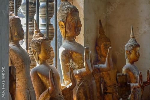 Laos Luang Prabang Wat Wisunalat buddha statues Poster