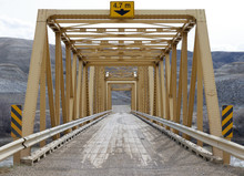 Yellow Steel Bridge On Gravel ...