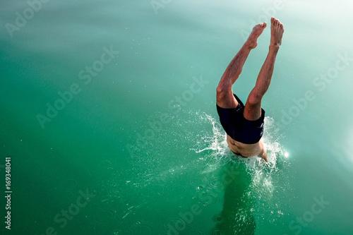 Photo  Diving and jumping from a boat at Balaton lake in Hungary