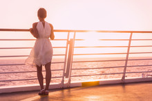 Cruise Ship Vacation Woman Luxury Travel Watching Sunset Over Ocean . Elegant Lady In White Dress On Deck Enjoying View Of Famous Holiday Destination. Girl On Honeymoon Getaway Happy Relaxing.