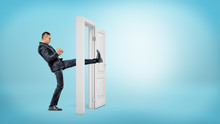 A Businessman In Side View Kicks A Small White Door Open With His Leg On Blue Backgrounds.