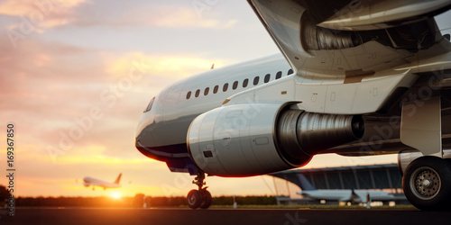 Türaufkleber Flugzeug White commercial airplane standing on the airport runway at sunset. Passenger airplane is taking off. Airplane concept 3D illustration.