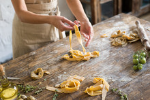 Raw Homemade Pasta And Hands