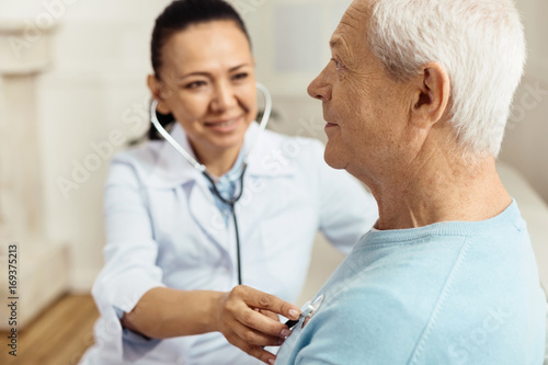 Pleasant senior man being examined Canvas Print