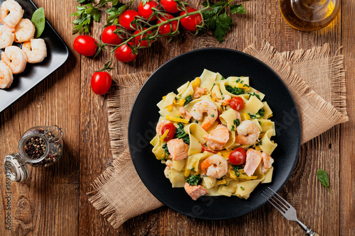 Traditional Italian fettuccini with salmon, shrimp and spinach.