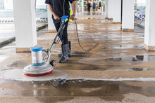 Worker Cleaning Sand Wash Exterior Walkway Using Polishing Machine And Chemical Or Acid