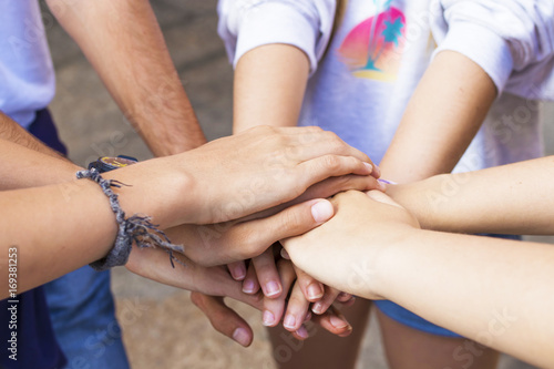 Fotografía  group of friends hands stacked and together, union and friendship