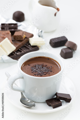 Foto op Canvas Chocolade hot chocolate on a white table, vertical