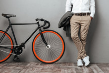 Dressed Half Mens Body Standing Near A Bicycle