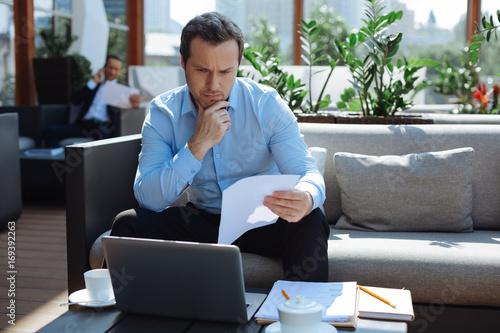 Fototapeta Thoughtful intelligent man holding his chin obraz na płótnie