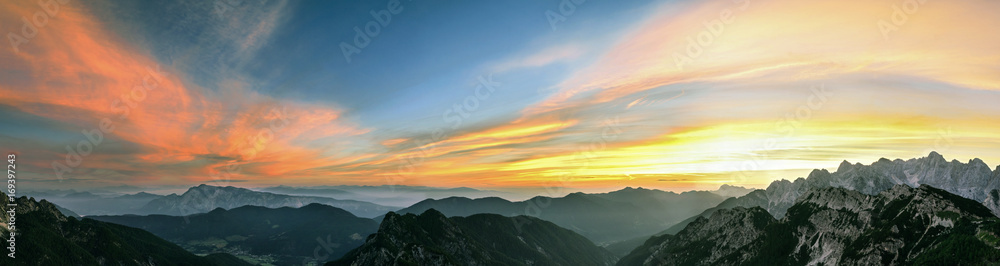 Fototapety, obrazy: Mountain landscape at sunset in Julian Alps. Amazing view on colorful clouds and layered mountains.