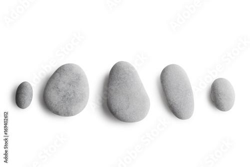 Fototapeta Grey pebbles on white background