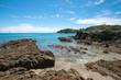 Panorama of stone seashore and blue sea New Zealand