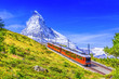 canvas print picture - Zermatt, Switzerland. Gornergrat tourist train with Matterhorn mountain in the background. Valais region.