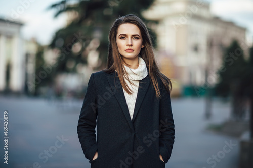 fototapeta na drzwi i meble Close up pretty woman portrait posing in the city street