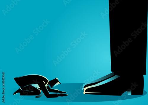 Businessman kneel down under giant feet Canvas Print