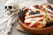 Halloween Mummies Mini Pizzas On Wooden Table.