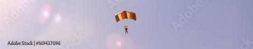 Fotografie, Obraz parachutist in a summer sky panorama
