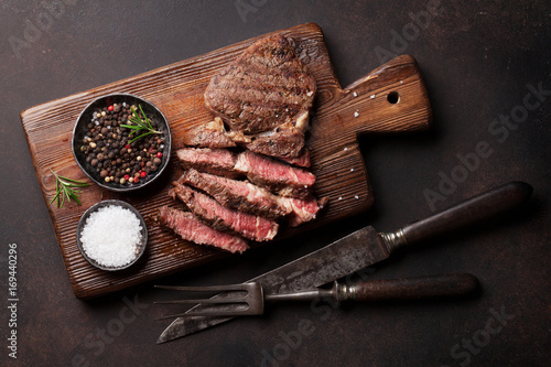 Garden Poster Steakhouse Grilled beef steak with spices on cutting board