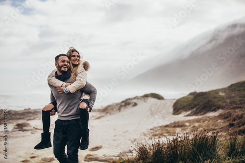 Couple enjoying winter holidays at the seashore