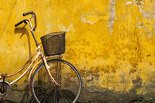 Old Bicycle Against Old Yellow Wall On A Street Of Hanoi Old Town, Vietnam.
