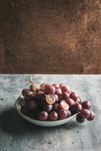 Purple Grapes In Bowl With Rusty Surface And Copyspace