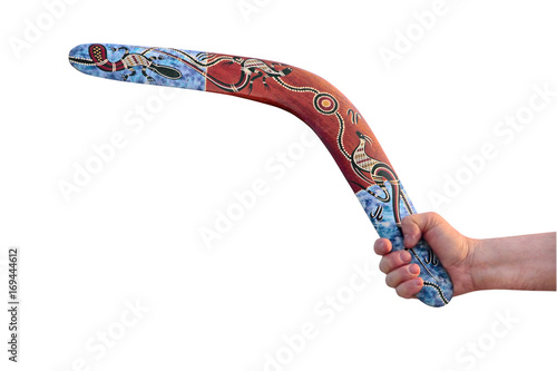Photo Multicolored Australian Boomerang in men arm taken closeup isolated on white