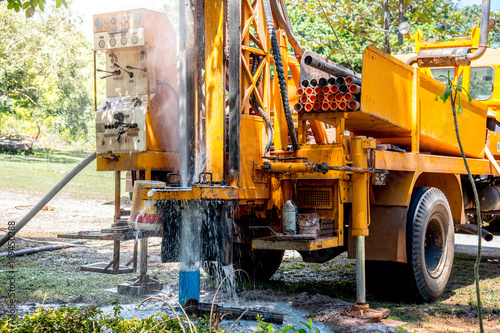 Fotografia  Ground water hole drilling machine installed on the old truck in Thailand