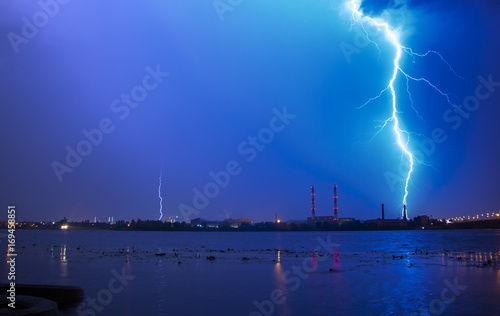 Spoed Fotobehang Onweer Lightning with dramatic clouds Night thunder-storm