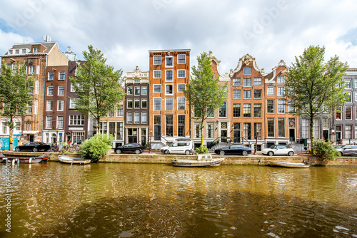 View on the beautiful old buildings and water channel in Amsterdam city Canvas Print