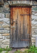 Old Wooden Door In Field Stone...