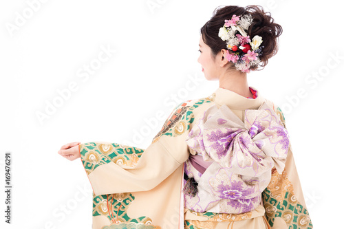 Canvas-taulu portrait of young asian woman wearing traditional kimono isolated on white backg