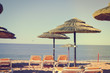 Sunny sky and chairs with parasol on the beautiful beach of Portugal
