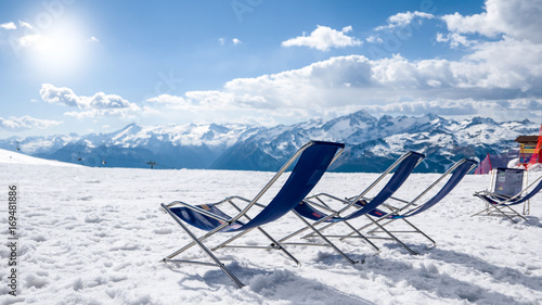 Relaxing armchairs at the top of the snowy mountain