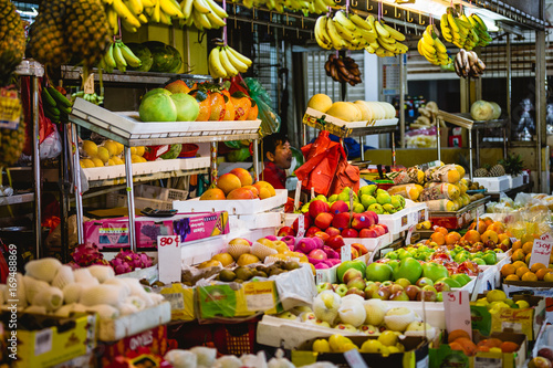 A colorful market stall full of fruits