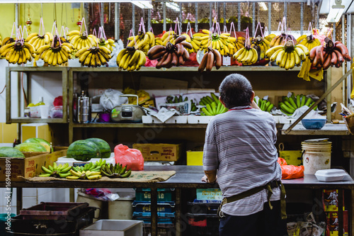 One man selling fruits on a market stall Canvas Print