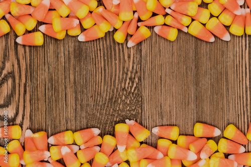 delicious fall halloween themed candy corn on a decorative wooden