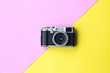canvas print picture - Flat lay vintage camera  on pastel background