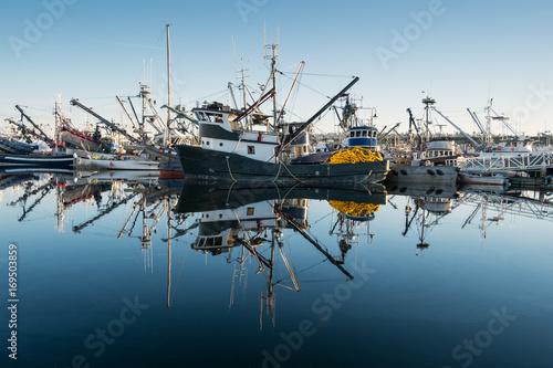 Fototapeta Fishing boats and reflections