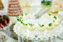 Luxury Served Glasses With White Desserts Stand On Mirror Tray