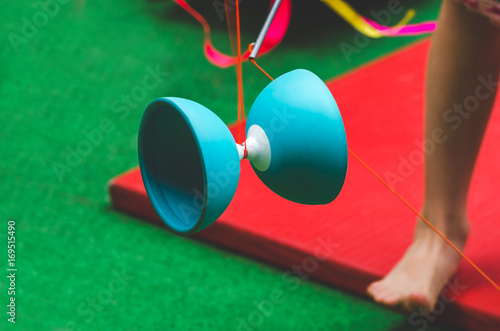 Child playing with Diabolo toy