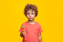 Adorable Kid With Lollipop