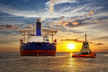 Tanker And Tugboat On Sea At S...